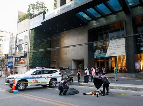 Two Koreans lay dead in front of I'M Hotel, Makati. The two are believed to have jumped.